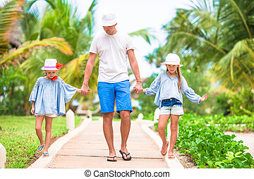 Happy family at tropical vacation having fun