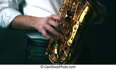 A musician playing saxophone in studio. Locked down, Real time.