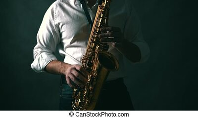 Real time shot of musician playing saxophone in studio. Locked down.