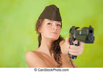 Topless girl aiming a gun - Topless girl aiming a black gun...