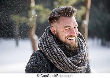 Adults can have fun in winter too! - Happy man smiling in...