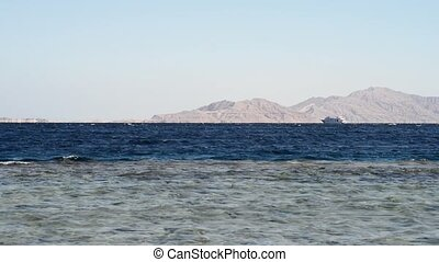boat in the sea. ship in the sea. beautiful evening landscape of sea and mountains. Evening view of the red sea