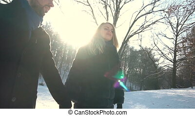 Young Couple Walks in Winter Park - Young happy family, boy...
