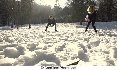 Young Couple Playing Snowballs - Young happy family, boy and...