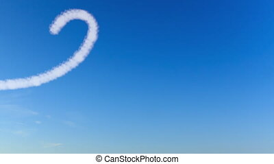 Writing word love with clouds