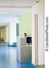 Hall in hospital - Long corridor in hospital with doors and...