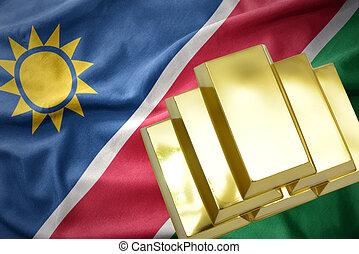 shining golden bullions on the namibia flag - gold reserves....
