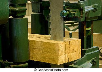 industrial band saw sawmill - industrial band saw cutting a...