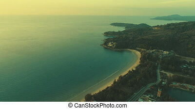 Sea and coastline of the beach at sunset - Aerial view of...