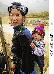 Black Hmong woman and baby - The Hmong live in small...