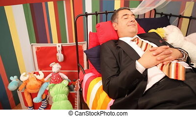Mature man sleeping in childrens b - Mature man wearing full...