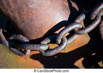 Old rusty anchor chain around the metal bollards - Old rusty...