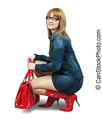 Stylish girl - Girl in blue dress ang red high boots with...