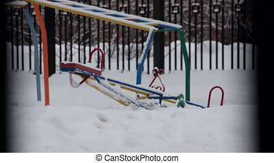 Children`s playground in winter with no one at it - Winter...