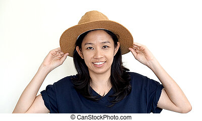 Asian girl wearing casual hat, smile and happy on white...