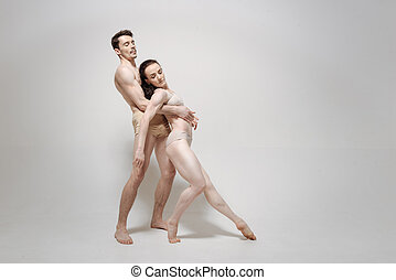 Charismatic couple acting isolated in white background -...