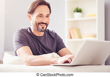 Cheerful smiling man sitting at the table - Inspiring work....