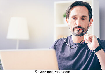 Thoughtful man sitting at the table