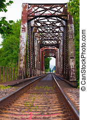 The old bridge and railroad tracks - Railway route with the...