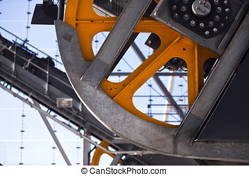 Industrial Linkage with orange trams flywheel with...