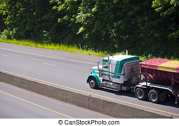Showy Semi truck classic rig and colored tilt trailer -...