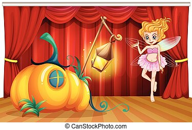 Fairy flying around pumpkin house on stage