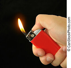 cigarette lighter - Hand with cigarette lighter isolated on...