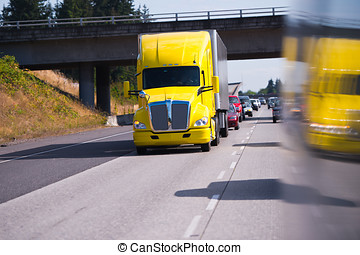 Big Rig Semi Truck on high way and truck reflaction - Bright...