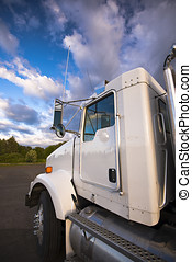 white_semi_truck_details_on_background_of_clouds_beauty