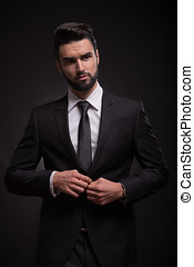 serious young man black suit