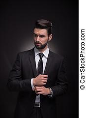young man elegant suit cufflinks hands