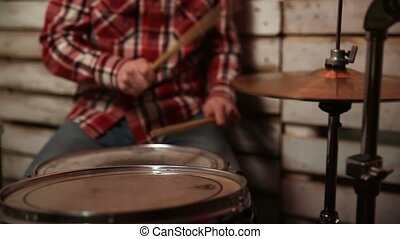 Drummer performing on his drum set. - The drummer in action....