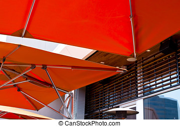 Modern bright orange awning with stainless steel tube - A...