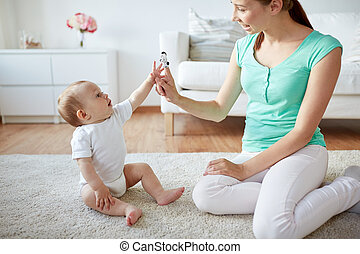 happy mother and baby playing at home