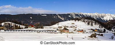 Winter Panorama with Piatra Craiului Mountains, Romania.
