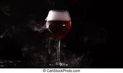 On a black background with glasses of red liquid coming out steam.