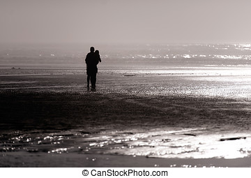 Silhouette of girl and guy West coast of Pacific Ocean -...