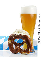 wheat beer with bavarian towel and pretzel on white background