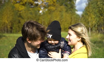 Young family in the park. - Happy mother, father and little...