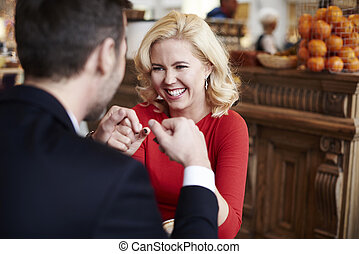Playful adult couple having some laughs