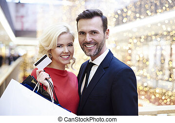Portrait of pretty couple in the shopping mall