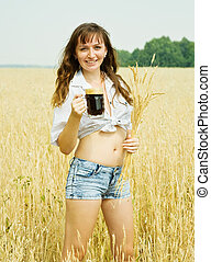 Girl with beer at field - Girl with beer and wheat ears at...