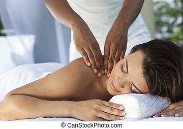 Woman At Health Spa Having Relaxing Massage - A young woman...