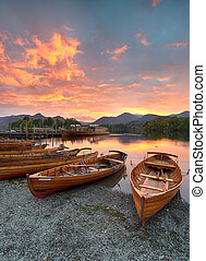 Boats at Keswick - A fiery sunset over boats on the shore of...