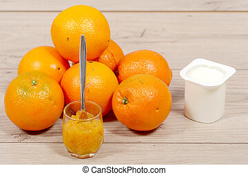 brunch of oranges and marmelade on wooden table