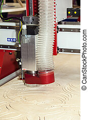 Wood milling machine in action close up process