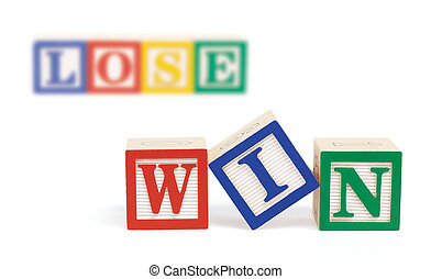 Win Lose Alphabet Blocks - Wooden alphabet blocks on white...