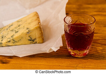 Glass of sloe gin with stilton cheese - Shot glass with slow...
