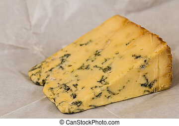 Wedge of Stilton Cheese - stilton cheese on unwrapped...