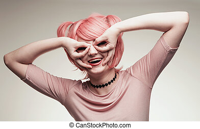 Portrait of girl in pink wig depicting Batman